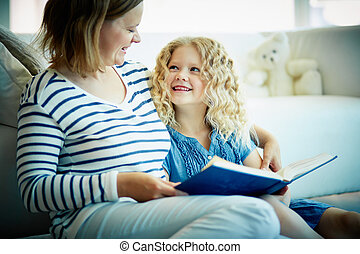 Story telling - Portrait of cute girl listening to her ...