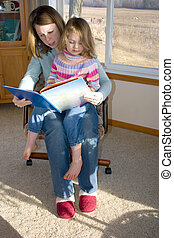 Storytime - a mother reading to her child
