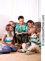storytime - reading to stories to her young children