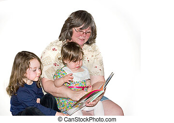 Storytime with Grandma - a grandmother reading a story to ...