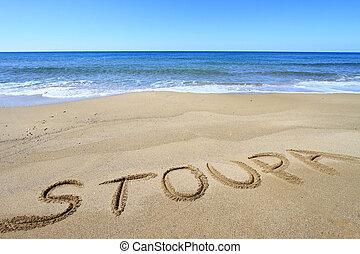 Stoupa written on sandy beach
