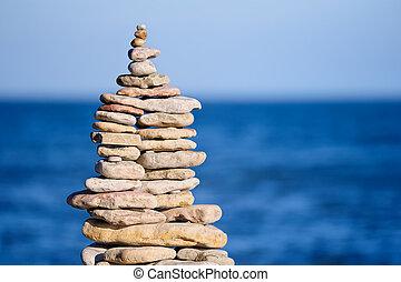 Stout pile of  cobblestone  on the sea shore