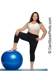 stout woman with blue ball fitness isolated on white