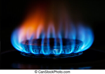 Burning hot blue yellow fire flames from a stove for cooking in a kitchen