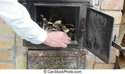 stove wood hand burn