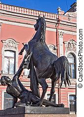 Sankt-Petersburg. Sculpture on Anichkov bridge through the...