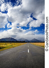 Straight empty road in the mountain, New Zealand