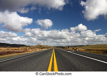 New Zealand - Straight road and beautiful clouds in New...