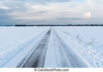 Straight road in a wintry landscape