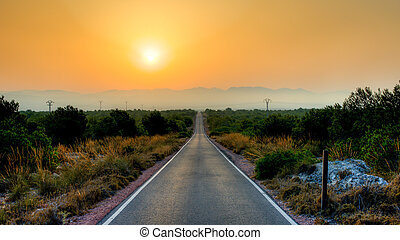 Straight road - A straight road leading to the hills