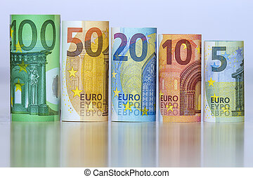 Straight row of accurately rolled hundred, fifty, twenty, ten and five new paper euro banknotes isolated on white background. Symbol of financial prosperity, wealth, success, savings and business.