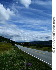 Straight summer road in Norway
