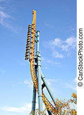 Straigth up roller coaster under blue sky