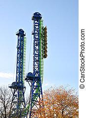 Straigth up roller coaster under blue sky