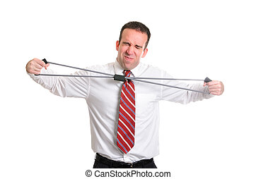 Strain - A young businessman straining to stretch a...