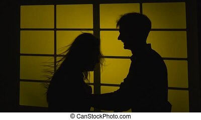 Strained relationship. Quarrel with a slap. Silhouette. Slow motion. Close up