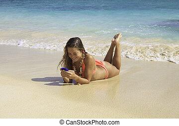 strand, bikini, texting, blond