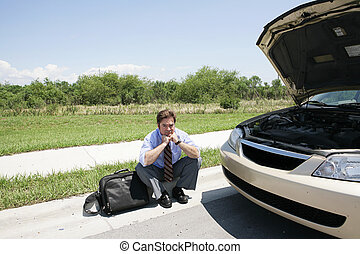 Stranded Self-Pity - A sad looking businessman sitting on...