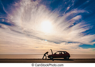 Stranded - Woman stranded due to car trouble on a desert...