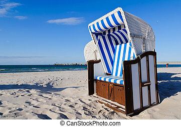 strandkorb (beach basket) in prerow at the baltic sea, germany