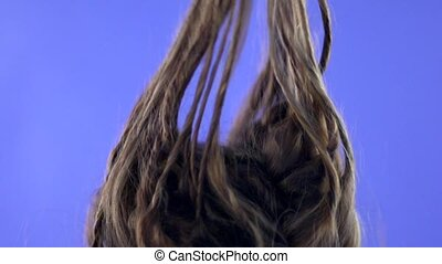 Strands of hair fall on the girl's head.