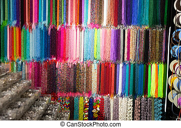 Strands of multicolored beads offered for sale in bijouterie store