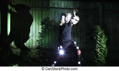 Strange dancing - Strange man dancing at night.