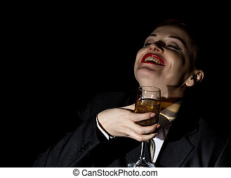 Strange girl in a man's suit drinks champagne, wildly and crazy laughs