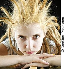 strange hairdo - young girl with a strange hairdo on a black...