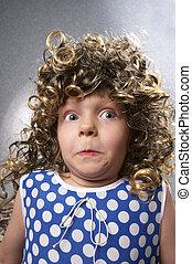 Strange little girl - Surprised strange funny little girl in...