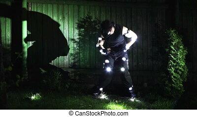 Strange man dancing at night.