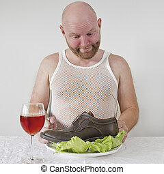 Wierd man eat his shoes with salad.