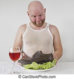 Strange Man Eats Shoes - Wierd man eat his shoes with salad.