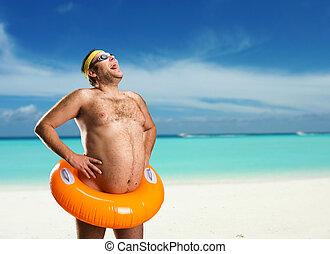 Strange man on the beach