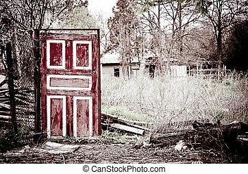 Strange old door standing among the remains - The strange...