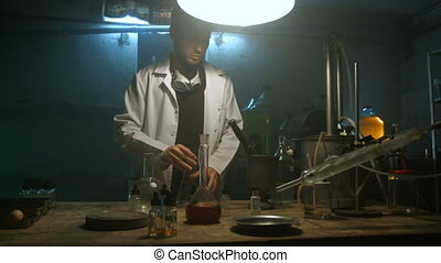 Strange scientist prepares a potion in the underground...