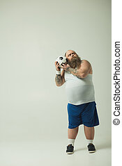 Strange thick guy playing with a football