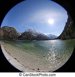 strange view like a hole by fisheye lens of alpine little lake c