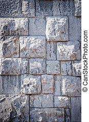 Strange wall with old blocks