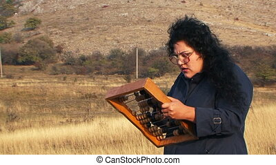 Strange Woman In Black Playing And Looking Through Beads Being At Nature