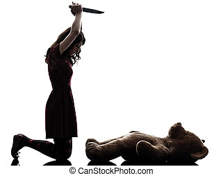 strange young woman killing her teddy bear silhouette - one...