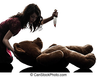 strange young woman killing her teddy bear silhouette