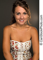 Strapless top - Portrait of a beautiful young brunette in a...