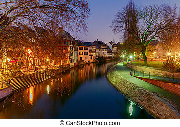 Half-timbered house on the canal at night in Strasbourg. Alsace.