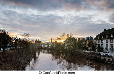Strasbourg sunset with cloudy and sunny sky