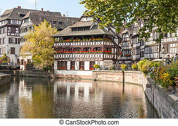 Strasbourg, water canal in Petite France area. timbered houses and trees in Grand Ile. Alsace, France.