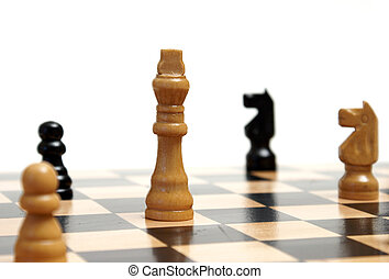 A closeup shot of a strategic game of chess.