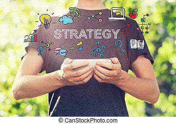 strategie, begriff, mit, junger mann, besitz, seine, smartphone, draußen