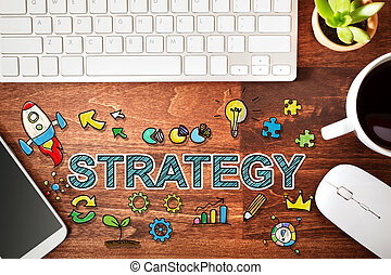 Strategy concept with workstation on a wooden desk