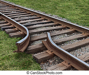 Strategy obstruction challenges with a train track that is broken as a business concept of a road block and finding solutions to obstacles that are dangerous and challenging as journey on a strategic goal.